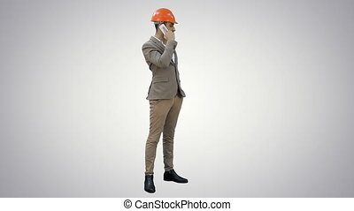 Contractor in hardhat talking on mobile phone on white background.