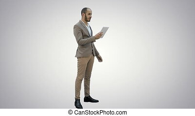 Businessman making video call using tablet on white...
