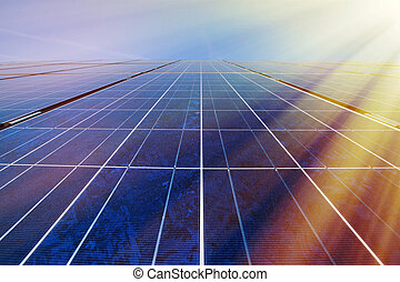 Solar panels in sunlight - Solar panels and blue sky with...