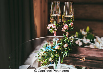 Two champagne glasses decorated with small boutonniere - Two...