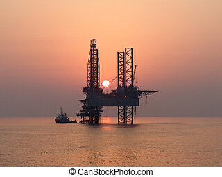 Sunset in Persian Gulf - Working boat and oil rig