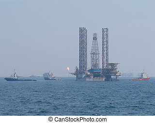 Oil rig move operation - Tug boats to move the oil rig