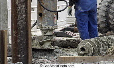 Industrial Earth Drill On Construction Site - Handheld...