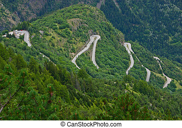 Alpe d'Huez - Curves and church - The famous hairpin curves...