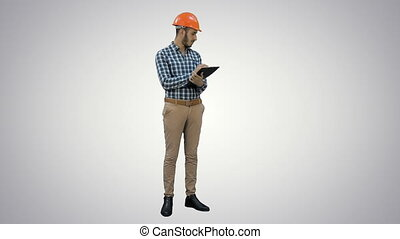 Engineer in helmet inspecting construction site on white background.