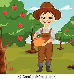 farmer little boy picking apples holding basket standing in orchard