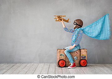 Summer vacation and travel concept - Child pretend to be...