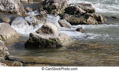 fast mountain river, pure water - Close-up of cascades and...