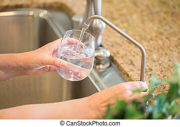 Woman Pouring Fresh Reverse Osmosis Purified Water Into...