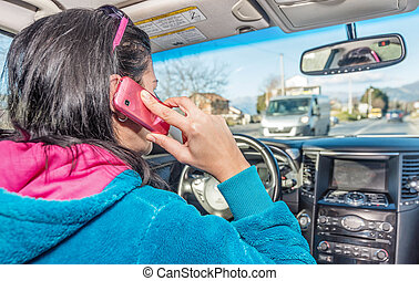 Woman using phone while driving a car