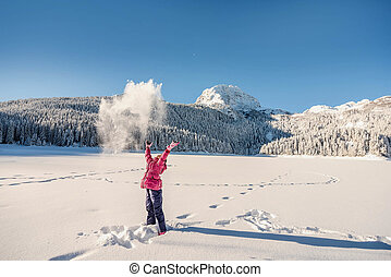 Little girl playing in snow covered Durmitor mountain in Montenegro