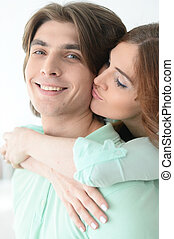 Beautiful young couple hugging