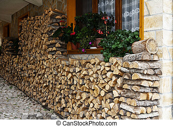 Stack of firewood near the house, Bulgaria - Background of...