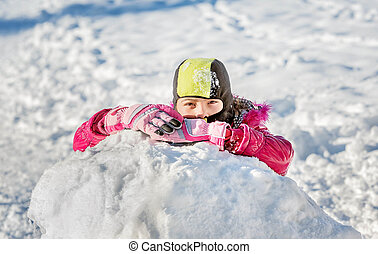 Little girl playing in snow in Montenegro