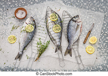 Preparing whole sea bream with thyme and salt