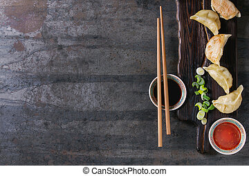 Gyozas potstickers with sauces - Gyozas potstickers on...