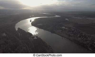 Aerial view of sunrise above winding river in Ukraine.
