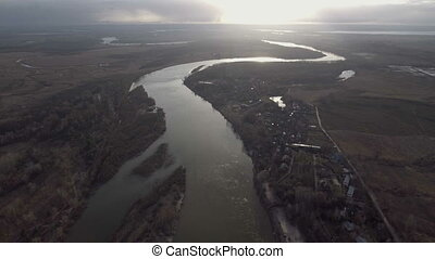 Flying over the beautiful River and Forest. Aerial camera...