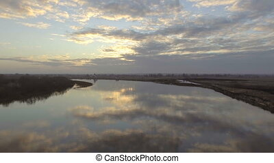 Low flying over the river. Aerial view.