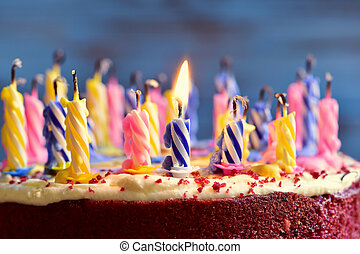 blowing out the candles of a cake - closeup of a cake with...