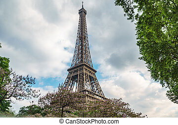 The Eiffel tower and cloudy sky - Wide angle of Eiffel tower...