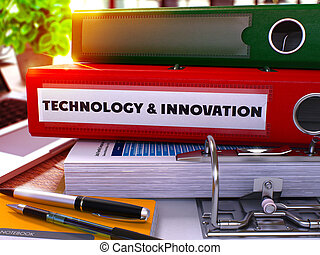 Red Ring Binder with Inscription Technology and Innovation.