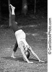 Yoga, sun salutation, downward facing dog