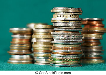 Coins stacked in piles