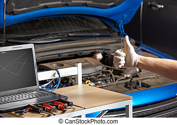 Mechanic hand show thumbup closeup to good electronic of...