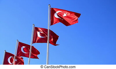 Turkish flags waving in the blue sky 2