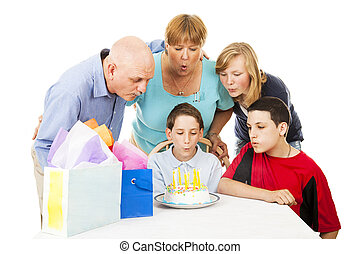 Birthday Family Blows Candles - Family helping a little boy...