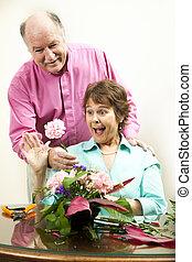 Flower Surprise - Woman arranging flowers gets a surprise...