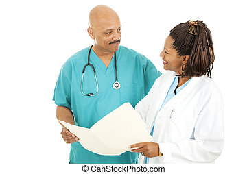 Doctors Discussing Chart