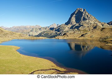 Pyrenees - Midi Dossau Peak reflected in Gentau lake. Ossau...