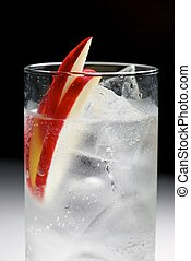 Gin Tonic - Apple gin tonic served in glass.