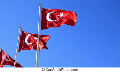 Turkish flags waving in the blue sky - Waving flags of...