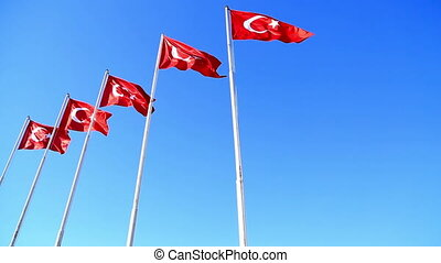 Turkish flags waving in the blue sky 2 - Waving flags of...