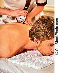 Man back massage beauty salon. Electric stimulation man skin...