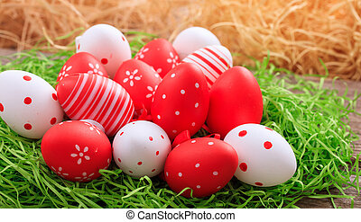Easter eggs on grass - Red and white Easter eggs on grass