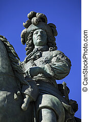 Louis XIVs statue in front of the Versailles Chateau