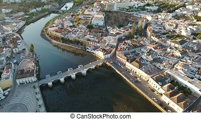 Aerial. Historical Tavira from the sky at sunset. Video of drone.