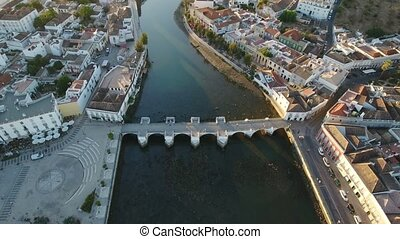 Aerial. Roman bridge of historical Tavira from sky, at...