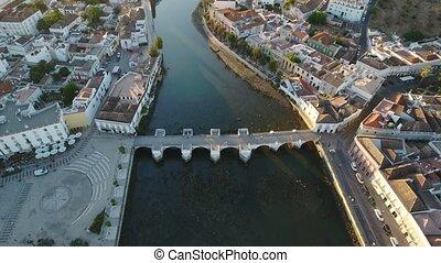 Aerial. Roman bridge of historical Tavira from sky, at...