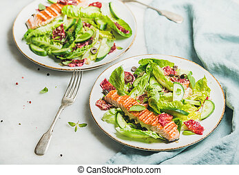 Healthy energy boosting spring salad with grilled salmon