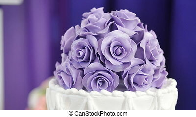 Beautiful cake with lilac flowers on top.