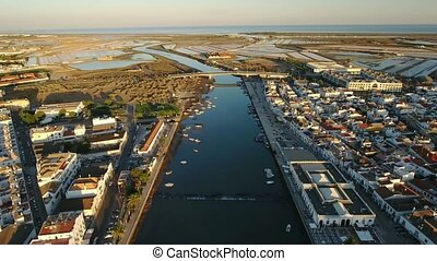 Aerial. View from the sky the sea and river Gilao in Tavira....