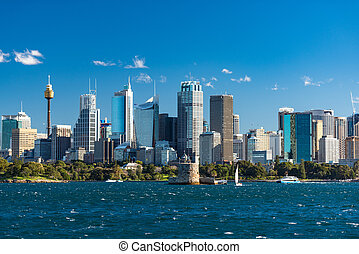 Sydney cityscape of Sydney CBD with ferries and yachts over...
