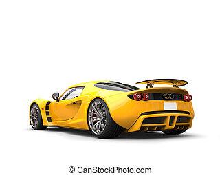 Warm yellow modern supercar - tail view