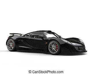 Metallic black modern supercar - studio shot