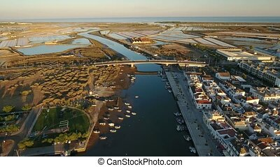 Aerial. Bridge over Gilao River in Tavira. View from the...